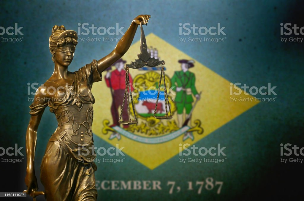 Lady Justice before a flag of Delaware - Royalty-free American Culture Stock Photo