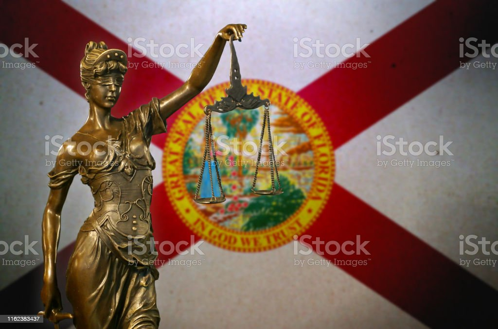 Lady Justice before a flag of Florida - Royalty-free American Culture Stock Photo