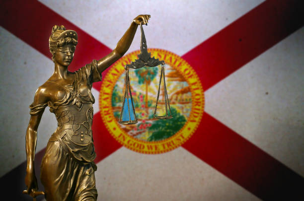 Lady Justice before a flag of Florida stock photo