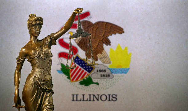 Lady Justice before a flag of Illinois stock photo