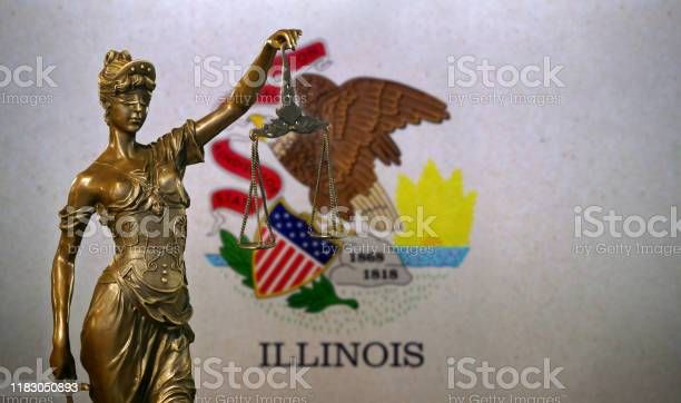 Lady Justice Before A Flag Of Illinois Stock Photo - Download Image Now