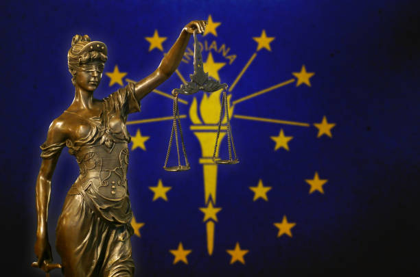 Lady Justice before a flag of Indiana stock photo