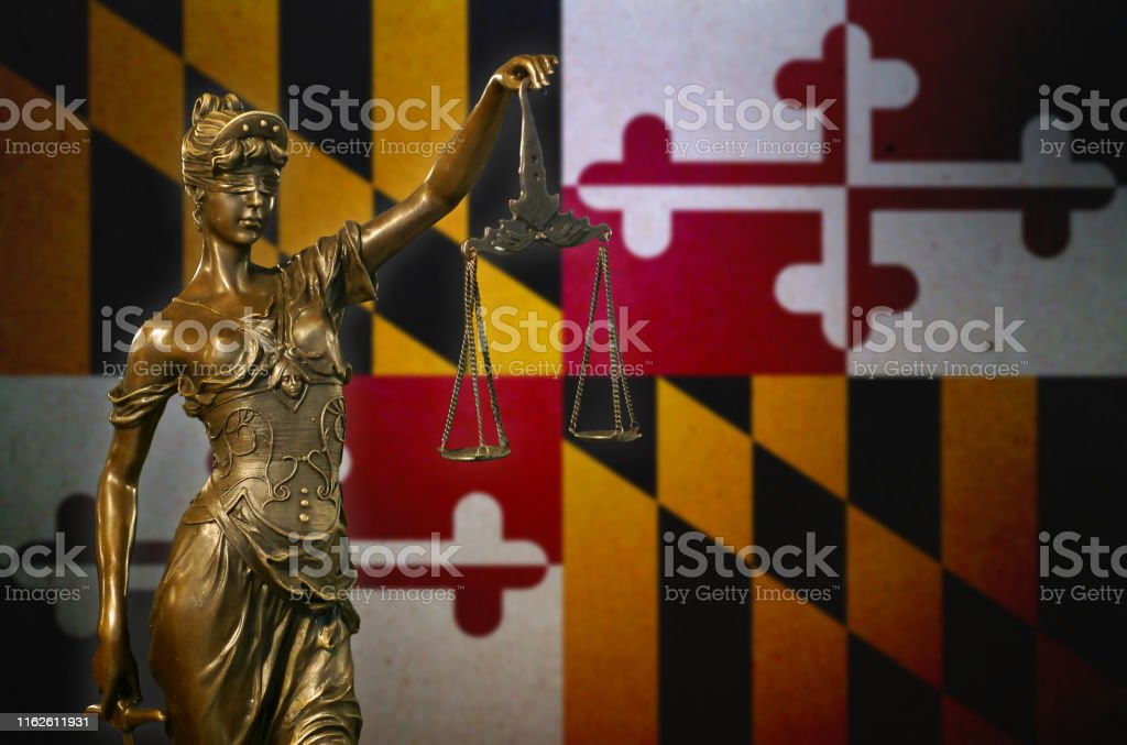 Lady Justice before a flag of Maryland - Royalty-free American Culture Stock Photo