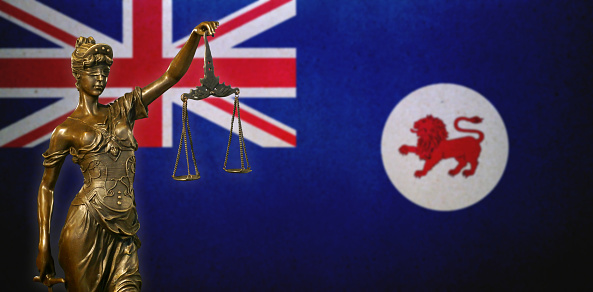 Lady Justice Before A Flag Of Tasmania Stock Photo - Download Image Now