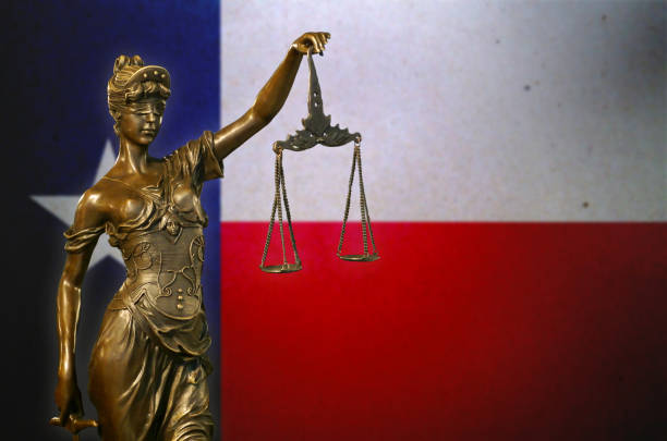 Lady Justice before a flag of Texas stock photo