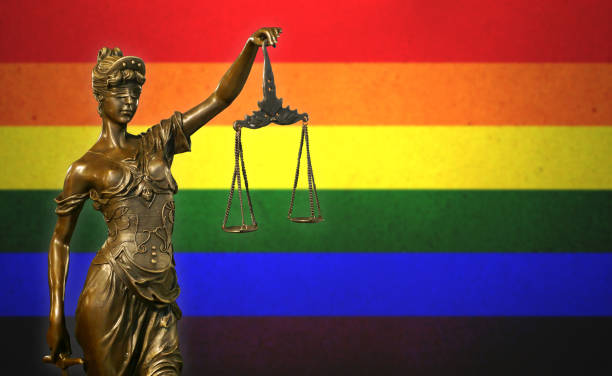 Lady Justice before a Rainbow flag stock photo