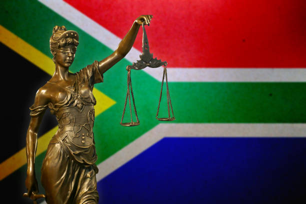 Lady Justice before a South African flag stock photo