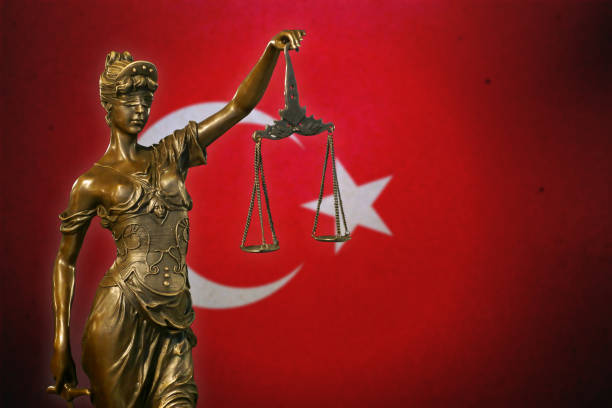 Lady Justice before a Turkish flag stock photo