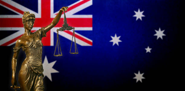 Lady Justice before an Australian flag stock photo