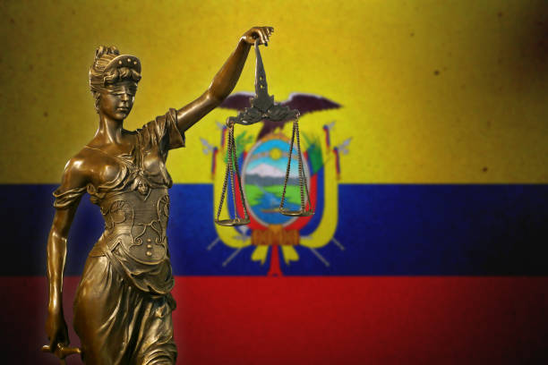 Lady Justice before an Ecuadorean flag stock photo