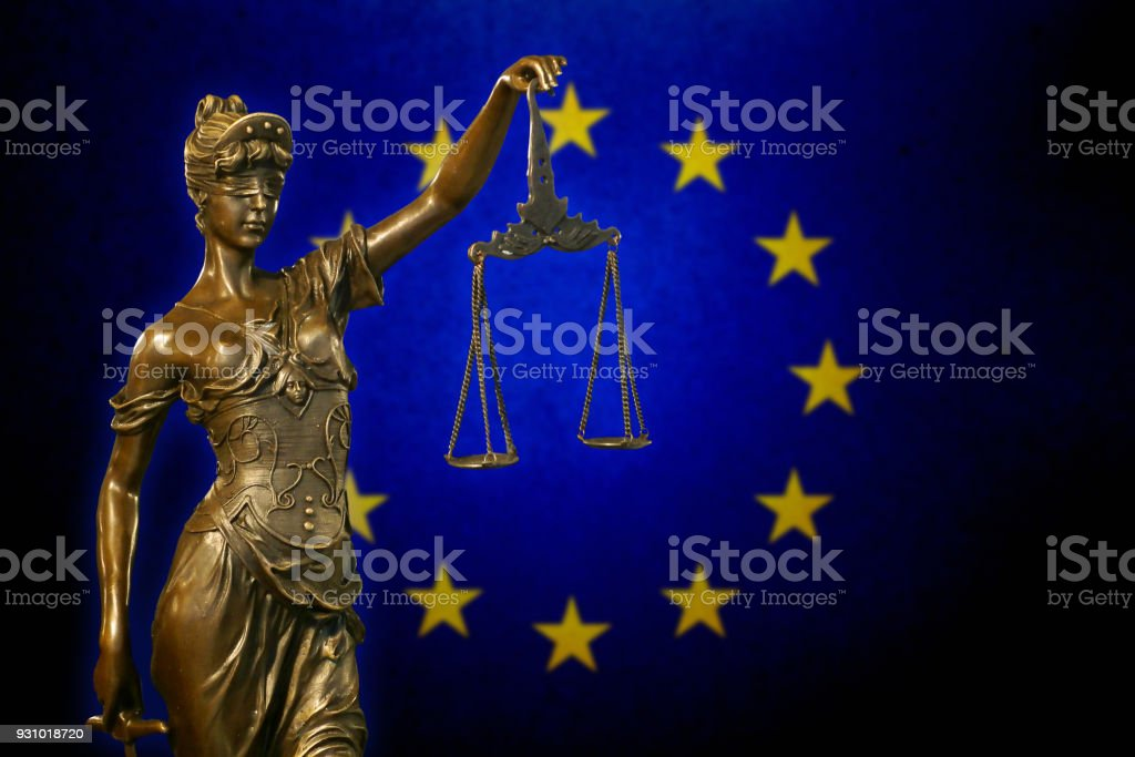 Lady Justice before the European Union flag stock photo