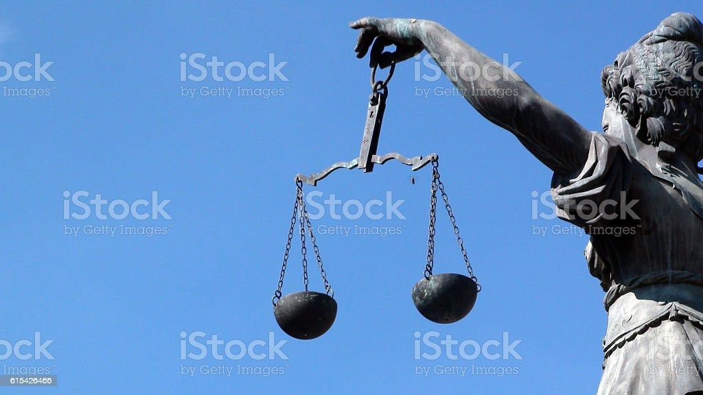 Lady Justice Holding Weight Scale Against Shining Blue Sky.Frankfurt.Germany.Europe stock photo