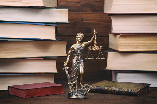 istock Lady Justice, law library concept, Law books in the background 1194651563