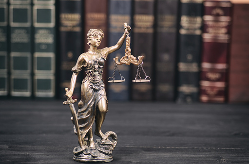 istock Lady Justice, law library concept, Law books in the background. 974627546