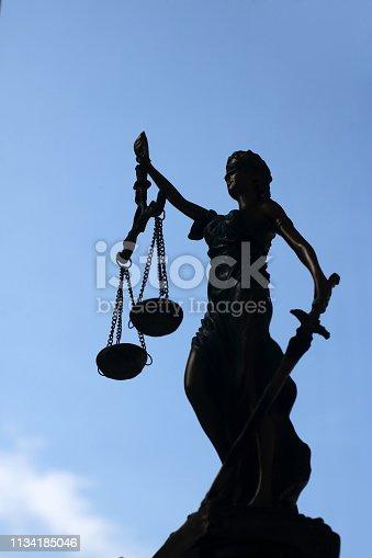 Lady justice on sky background