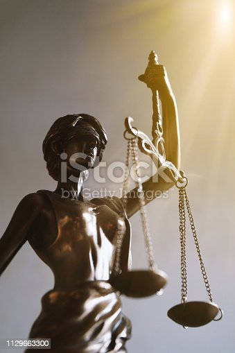 istock lady justice or justitia figurine law and legal symbol 1129663300