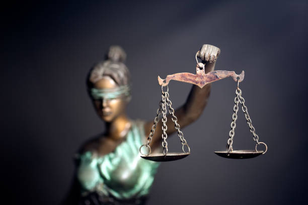 lady justice - imbalance stock photos and pictures