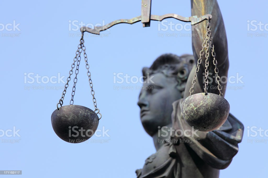 Lady Justice side view through scale stock photo