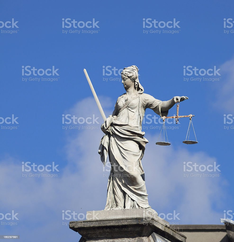 Lady Justice (Justitia) statue in Dublin Statue of Lady Justice/Justitia at the Dublin Castle - different than most depictions of Justitia, this statue is not blindfolded. Architectural Feature Stock Photo