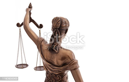 Lady Justice statue is the Greek ancient goddess Themis a symbol of justice isolated on white