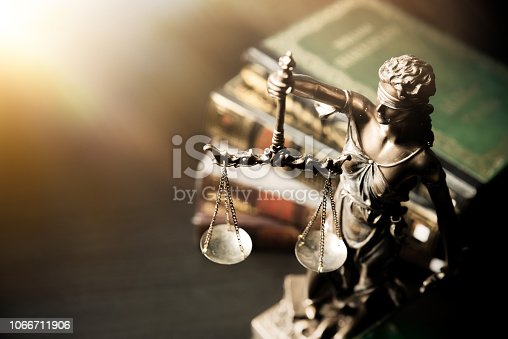 istock Lady justice. Statue of Justice in library 1066711906