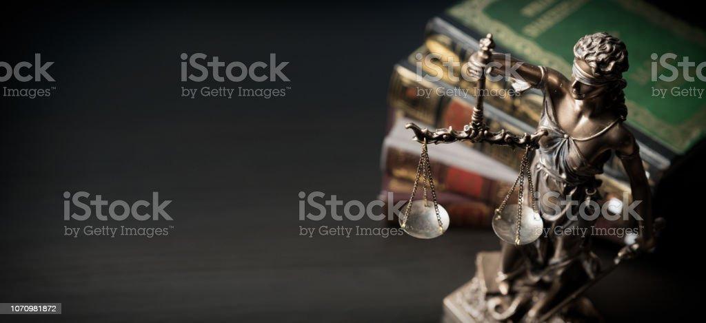 Lady justice. Statue of Justice in library stock photo