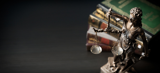 Lady Justice Statue Of Justice In Library Stock Photo - Download Image Now