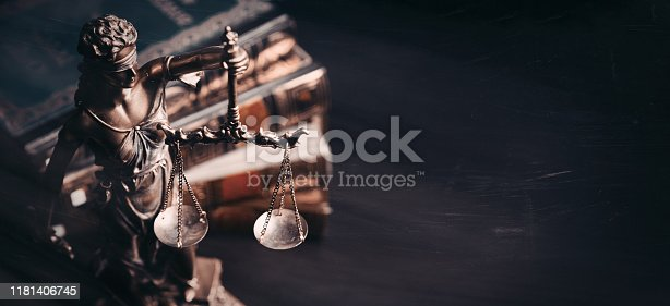 istock Lady justice. Statue of Justice in library 1181406745