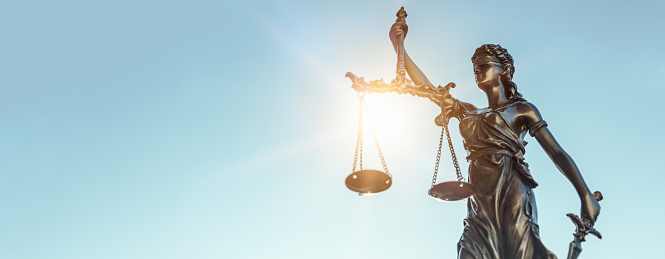 istock Lady justice. Statue of Justice on sky background 1181406847