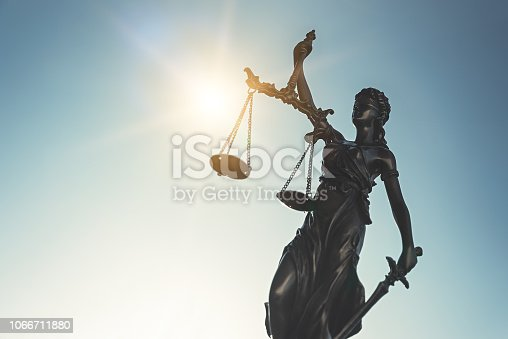 1070981872istockphoto Lady justice. Statue of Justice, Themis on sky 1066711880