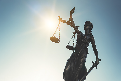 istock Lady justice. Statue of Justice, Themis on sky 1066711880