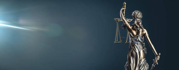 Lady Justice Statue Statue of lady justice on dark background - rear view with copy space. courtroom stock pictures, royalty-free photos & images