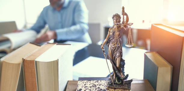 Lady Justice Statue The Statue of Justice - lady justice or Iustitia / Justitia the Roman goddess of Justice standing on books in lawyers office legislation stock pictures, royalty-free photos & images