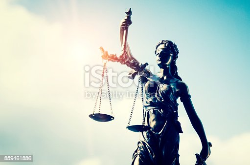 istock Lady justice, themis, statue of justice on sky background 859461886