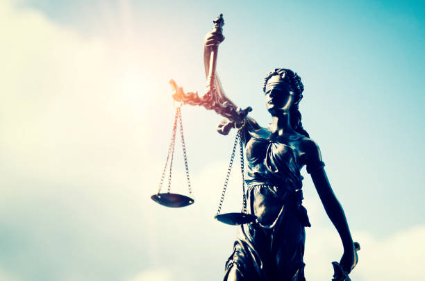 Lady justice, themis, statue of justice on sky background Lady justice, themis, statue of justice on sky background. law attorney court lawyer judge courtroom legal lady concept criminal stock pictures, royalty-free photos & images