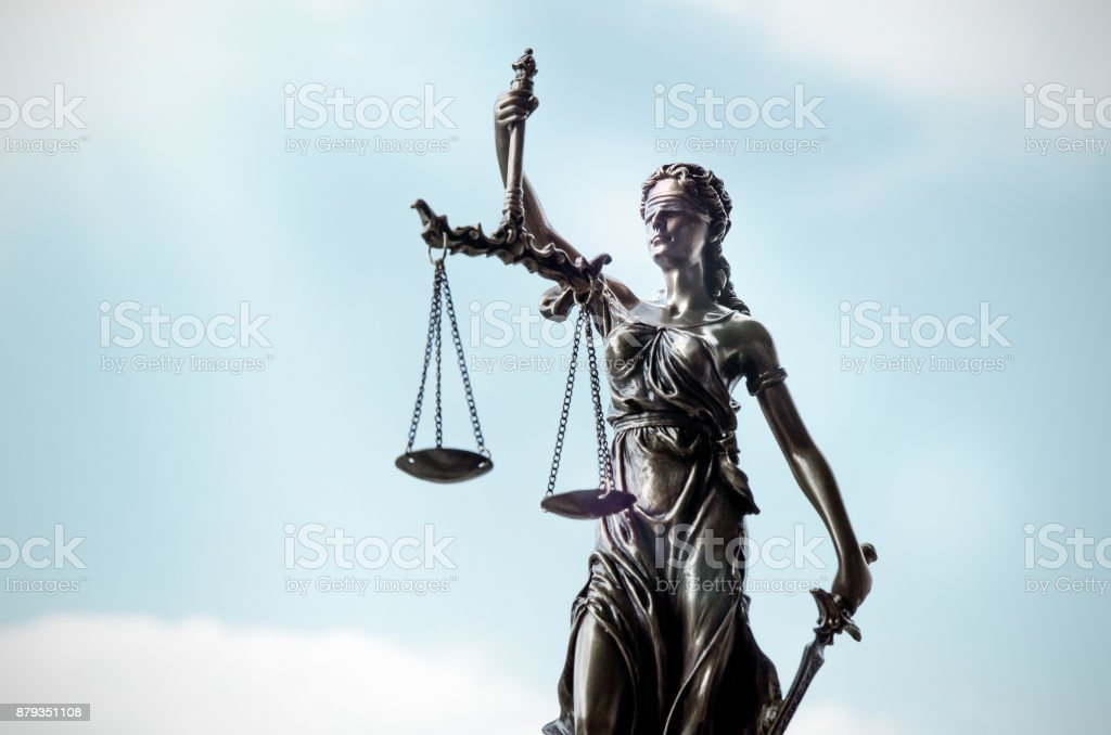 Lady justice, themis, statue of justice on sky background stock photo