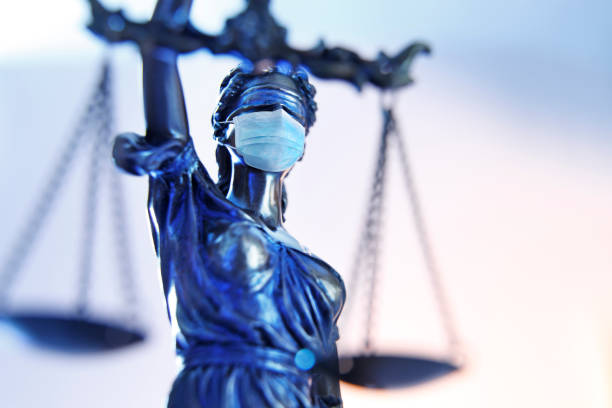 Lady Justice Wearing A Protective Face Mask stock photo