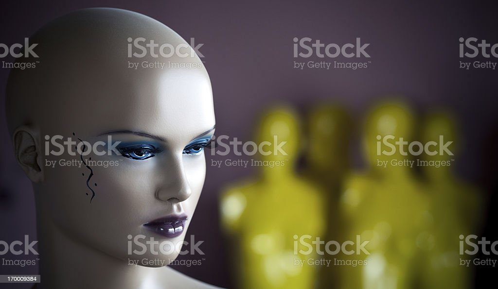 Lady mannequin face and unfocused man mannequins royalty-free stock photo