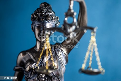 Lady of Justice or Themis on blue background