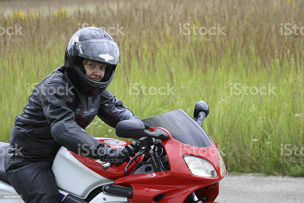 Lady on motorcycle royalty-free stock photo