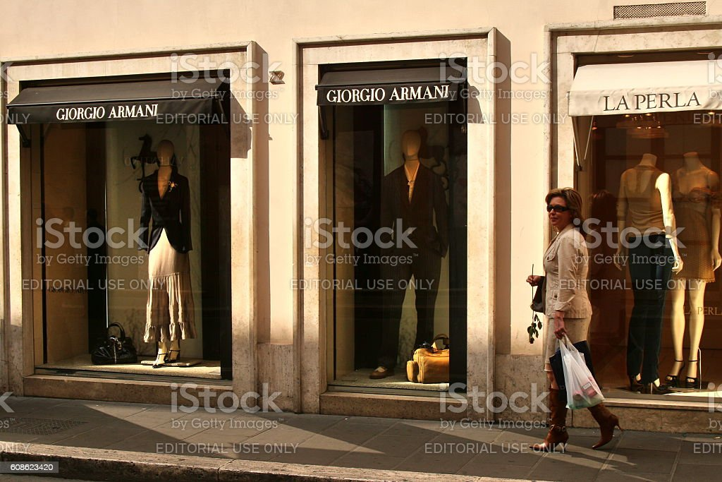 lady on shopping tour in front of shopping stores stock photo