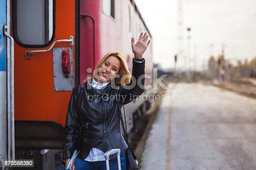 Lady on station waving