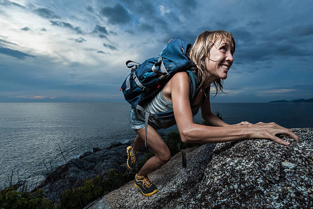 lady on the rock - endurance stock photos and pictures