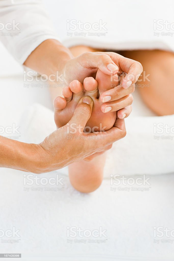 Lady pampering her feet by beauty therapist at spa royalty-free stock photo