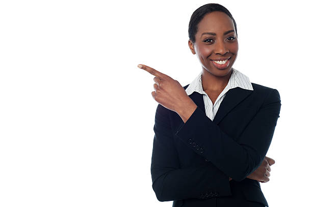 Lady pointing towards copy space area stock photo