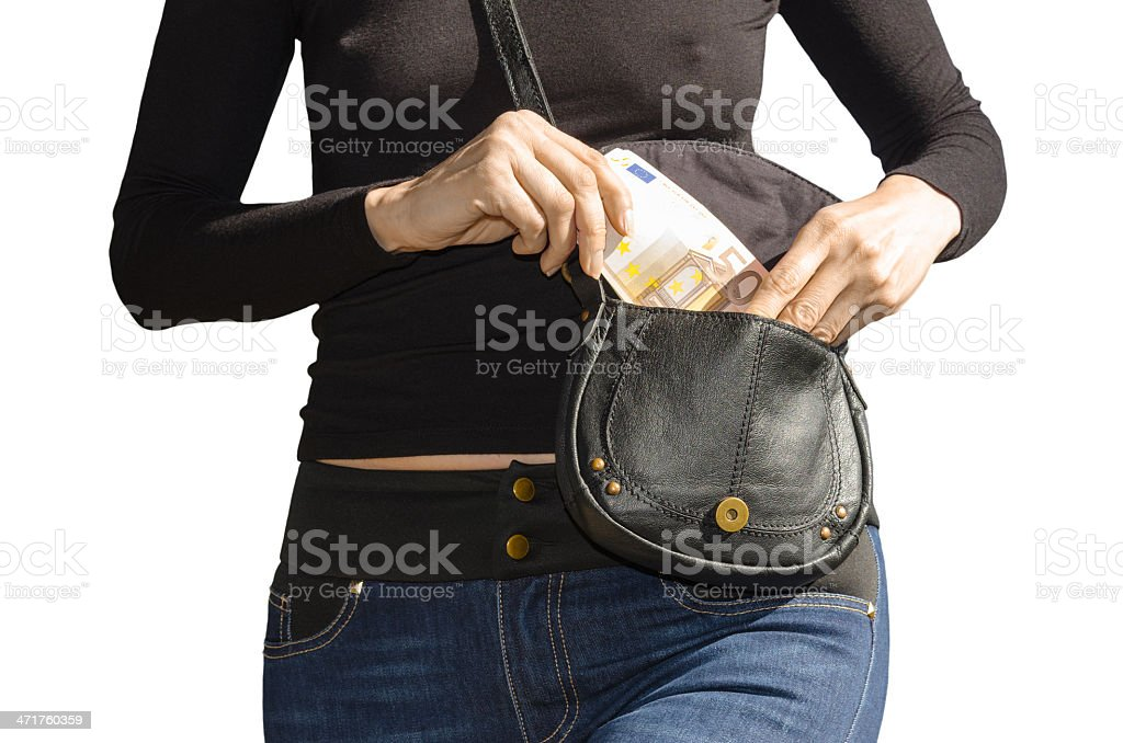 Lady pulls out of her handbag a banknotes 50 euro royalty-free stock photo