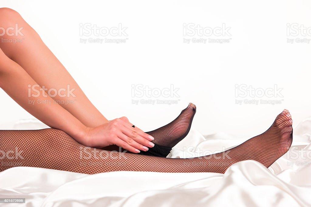 Lady puts on stockings. photo libre de droits