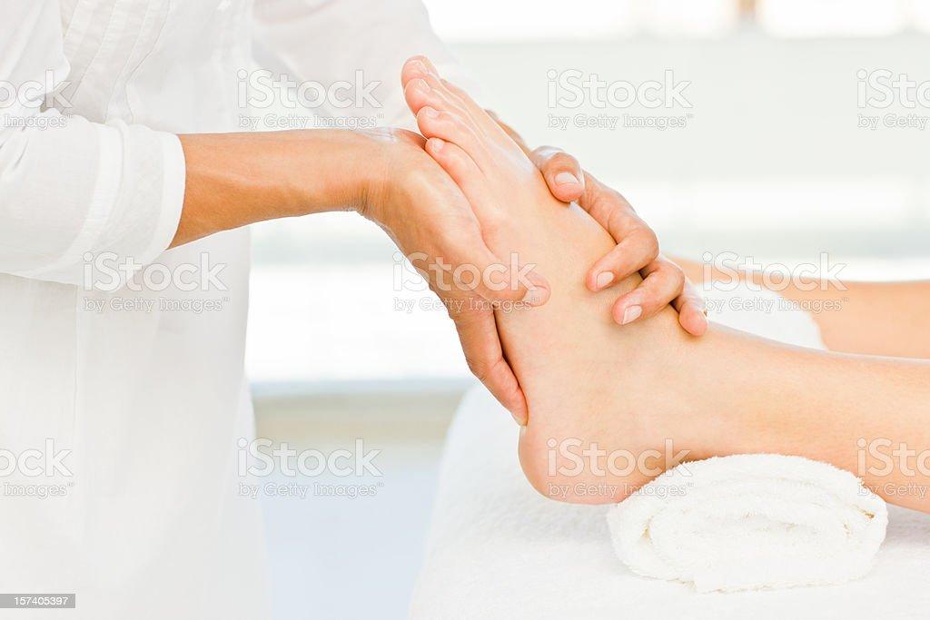 Lady recieving foot massage at spa royalty-free stock photo