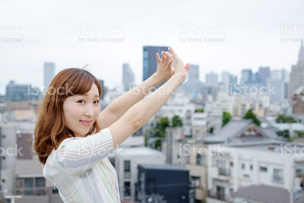Lady relaxing at a city royalty-free stock photo