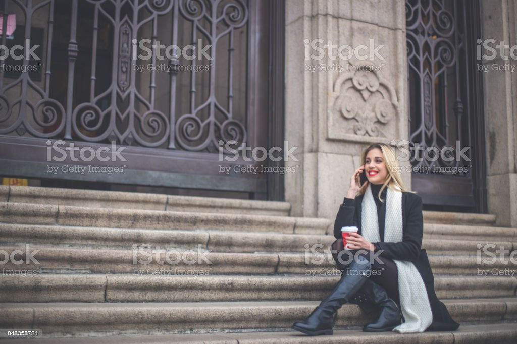 Lady relaxing on steps stock photo